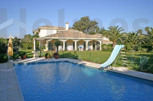 A substantial villa finished to high specificacions and set in lovely private lawned gardens.