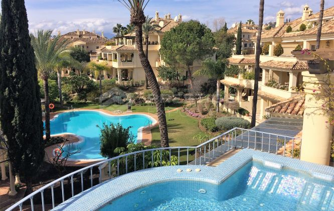 Duplex penthouse is located in the gated development Las Alamandas