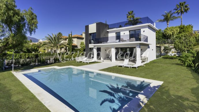Fully refurbished villa for sale within a gated community near golf