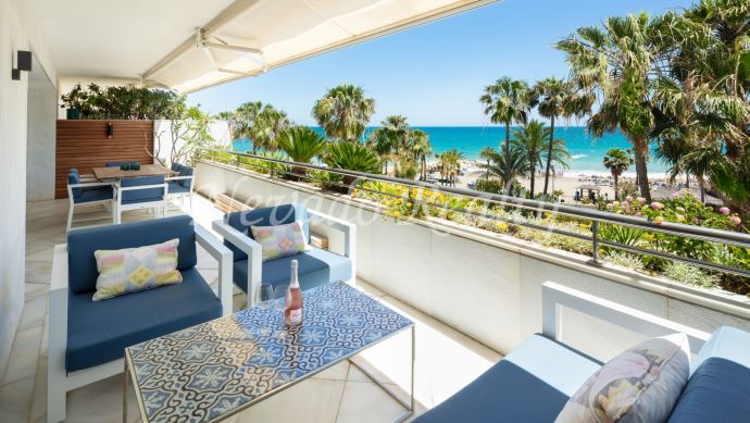 Beachfront penthouse for sale in private and exclusive development in Puerto Banús