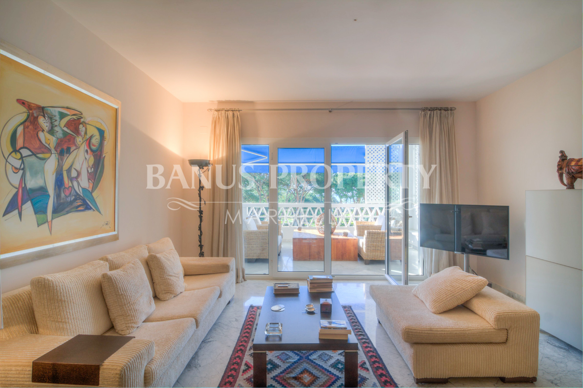 Three-bedroom first floor south-facing apartment for sale in Edificio Sevilla, Playas del Duque, Puerto Banús