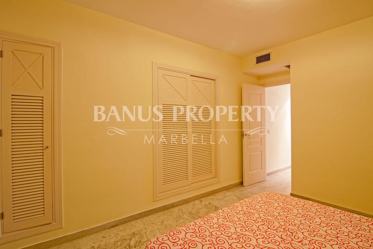 Elevated two-bedroom ground floor apartment for sale in Edificio Malaga, Playas del Duque, Puerto Banús