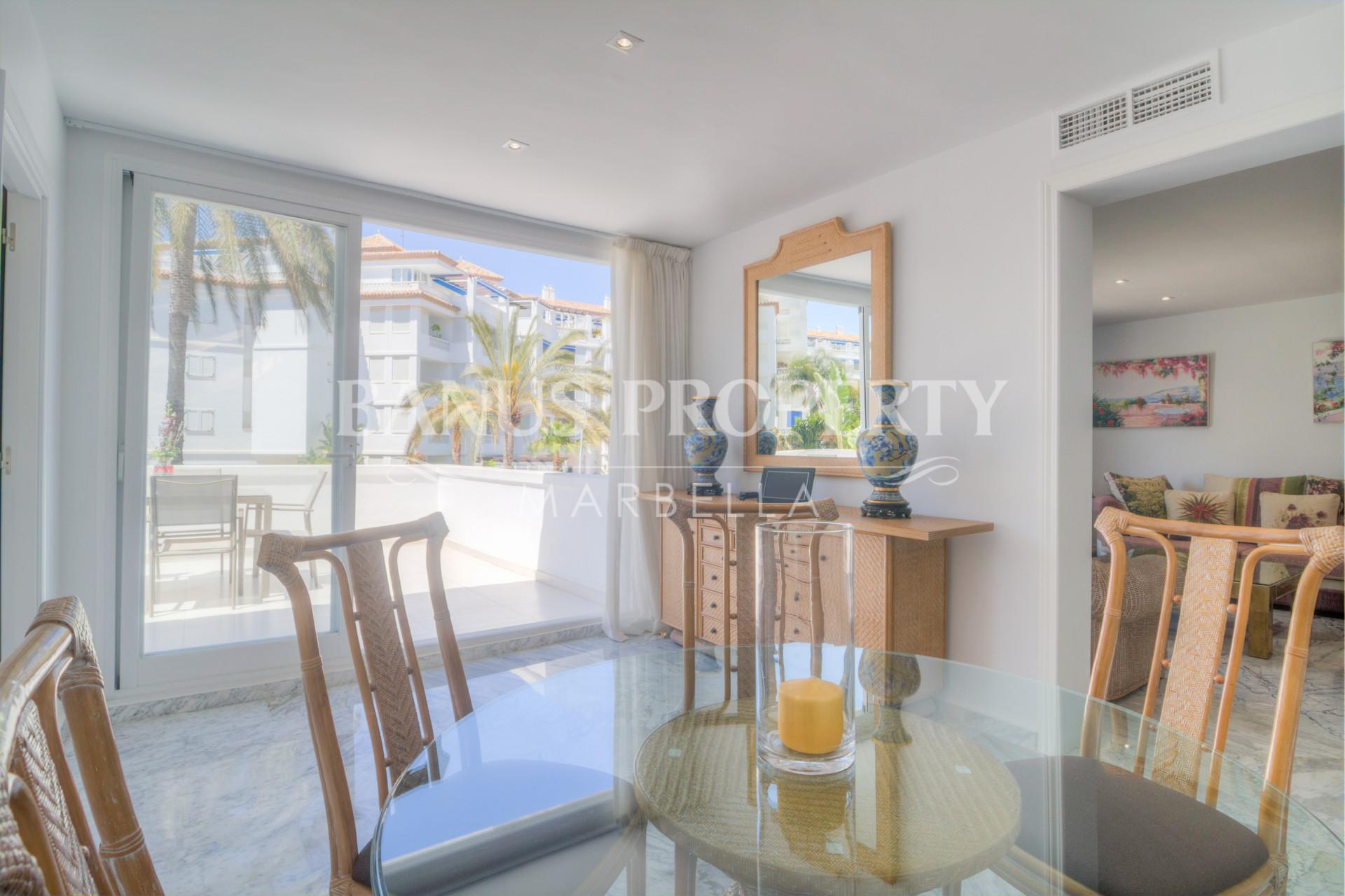 Immaculate three-bedroom first floor apartment for sale in Edificio Sevilla, Playas del Duque, Puerto Banús