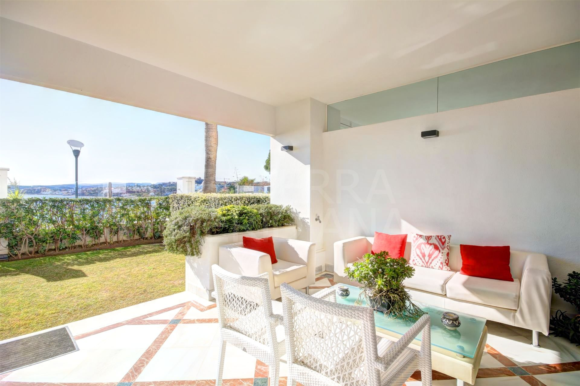 2 bedroom ground floor apartment with open sea views for sale in an exclusive development in Doncella Beach, Estepona