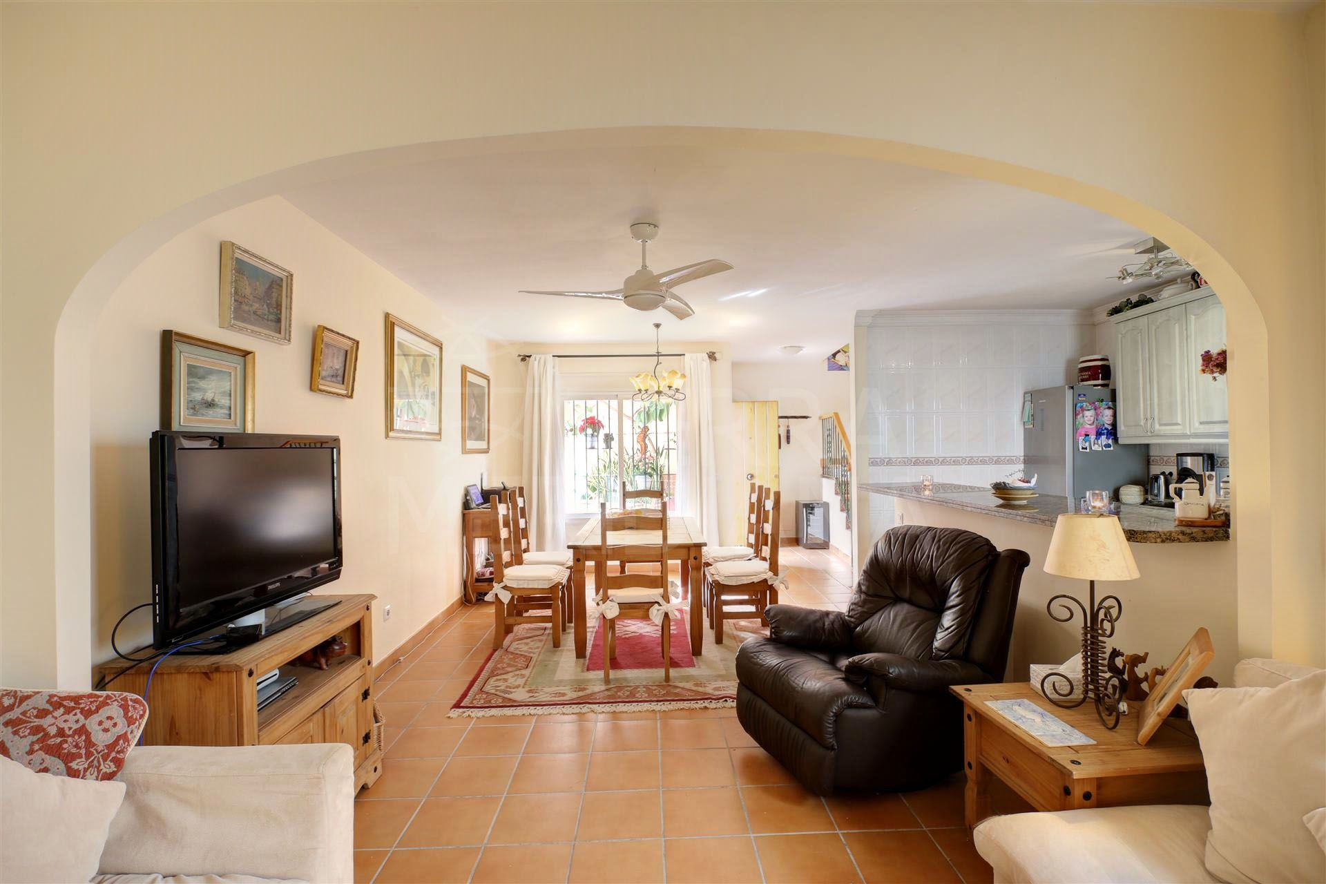 Townhouse for sale in Estepona, within a gated complex with private garage less than 100m from the beach
