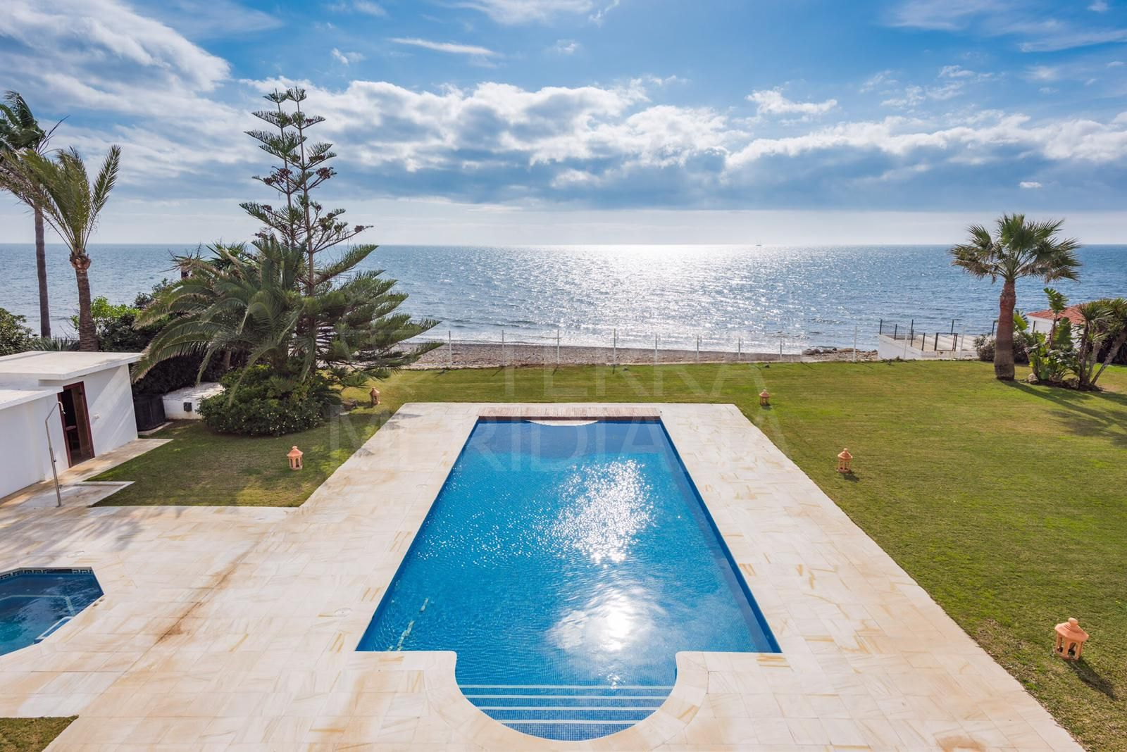 Breathtaking palacete style luxury beachfront villa with far-reaching sea views for sale in Guadalmina Baja, Casasola
