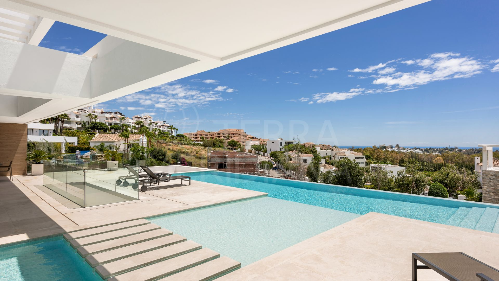 Contemporary luxury villa with a sea and golf panorama for sale in prime La Alqueria, Benahavis
