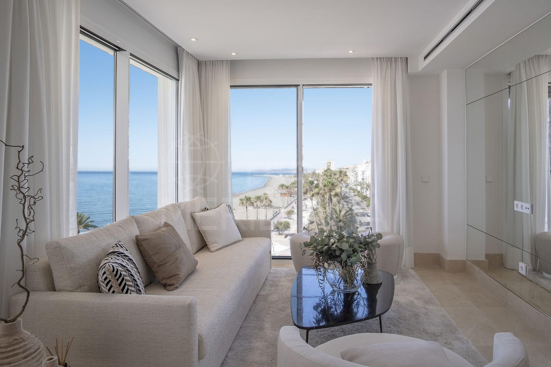 Recently upgraded frontline beach penthouse with a scenic panorama for sale in one of Estepona´s most emblematic buildings