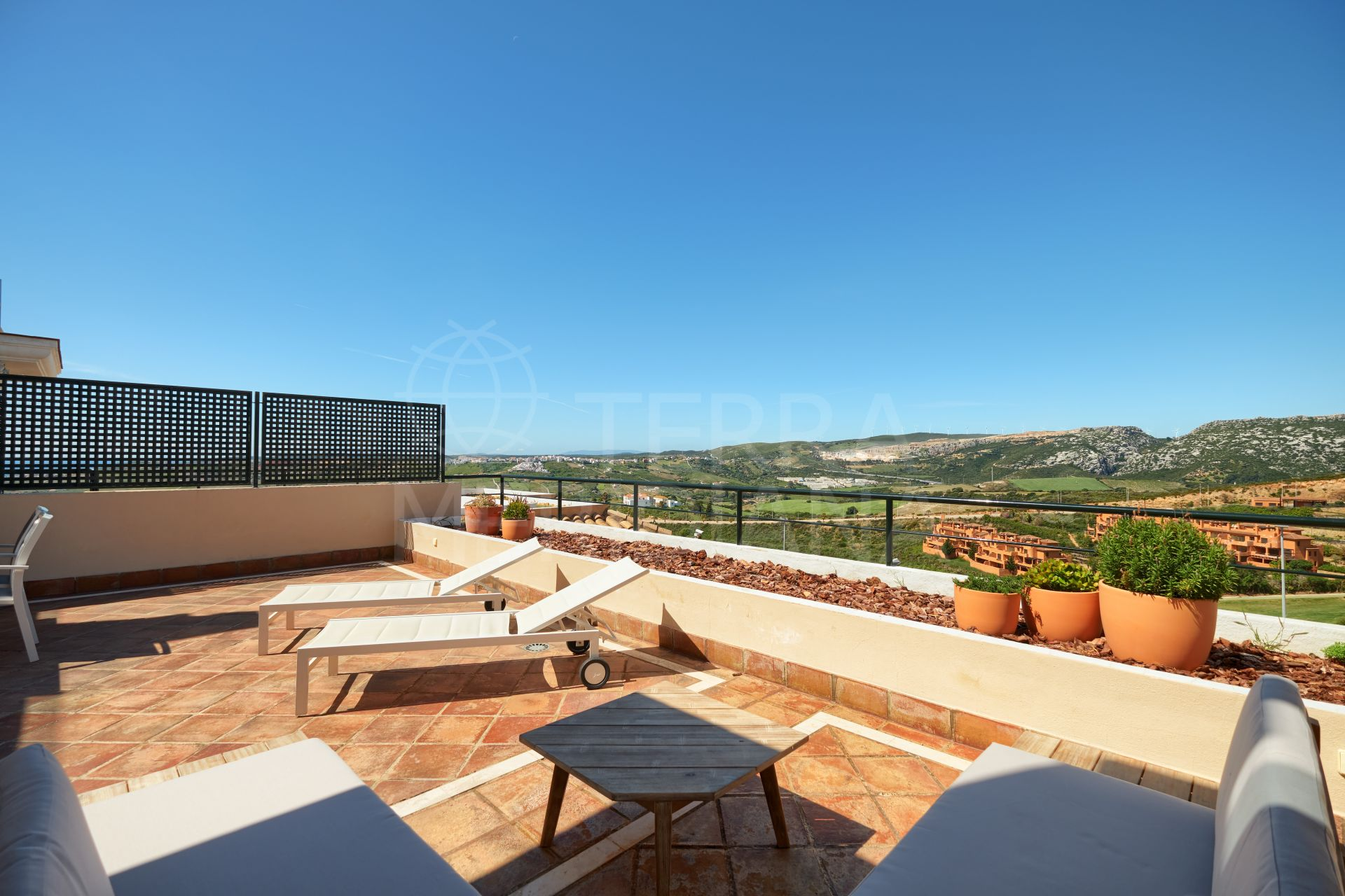 Elegant ground floor apartment with sea and golf vistas for sale in La Herencia next to Doña Julia golf course, Casares