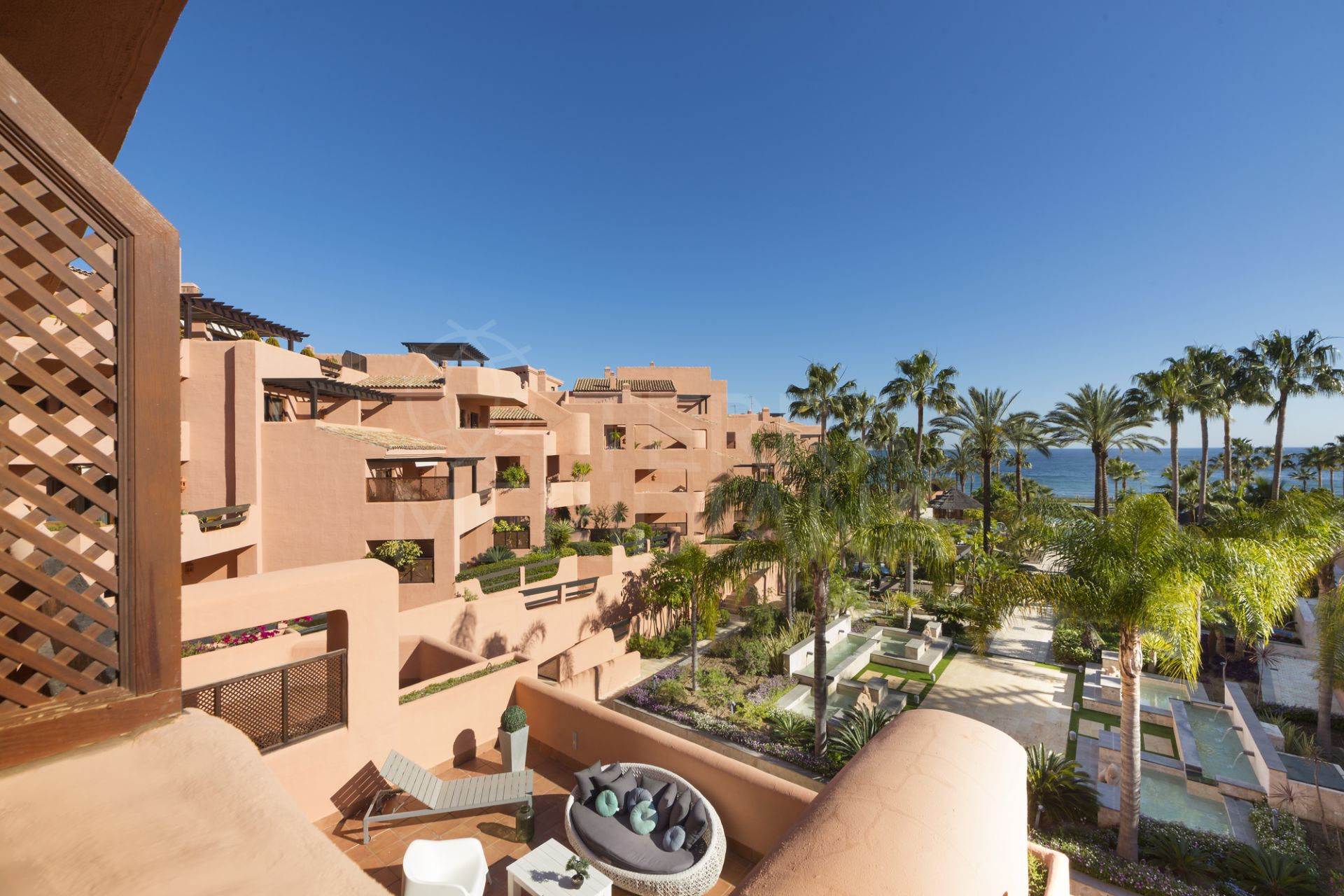 Ground floor apartment with private garden for sale, front line beach in Mar Azul, Estepona