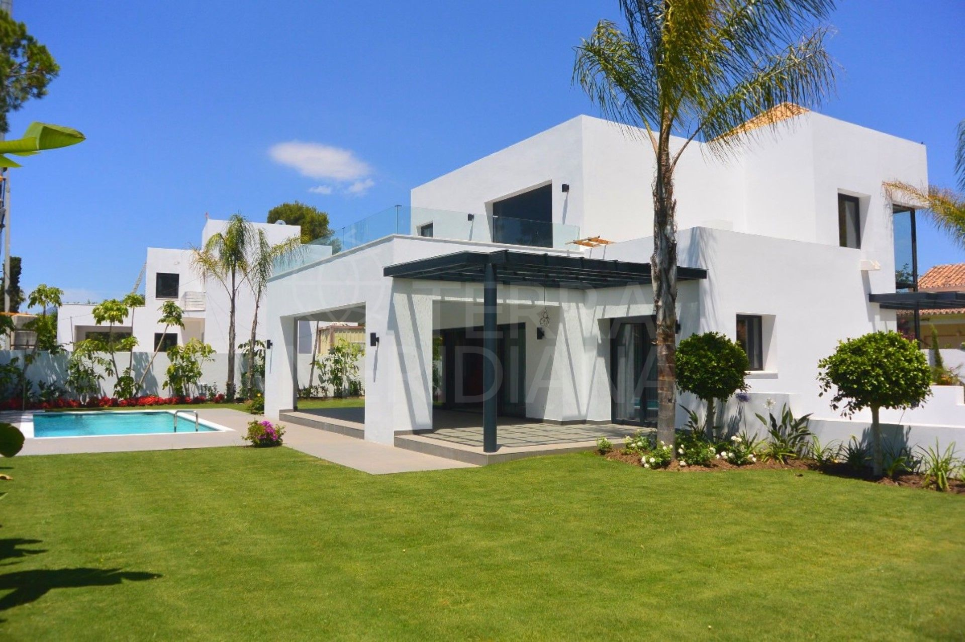 Contemporary family villa for sale, with private pool and sea views, close to the beach, New Golden Mile, Estepona