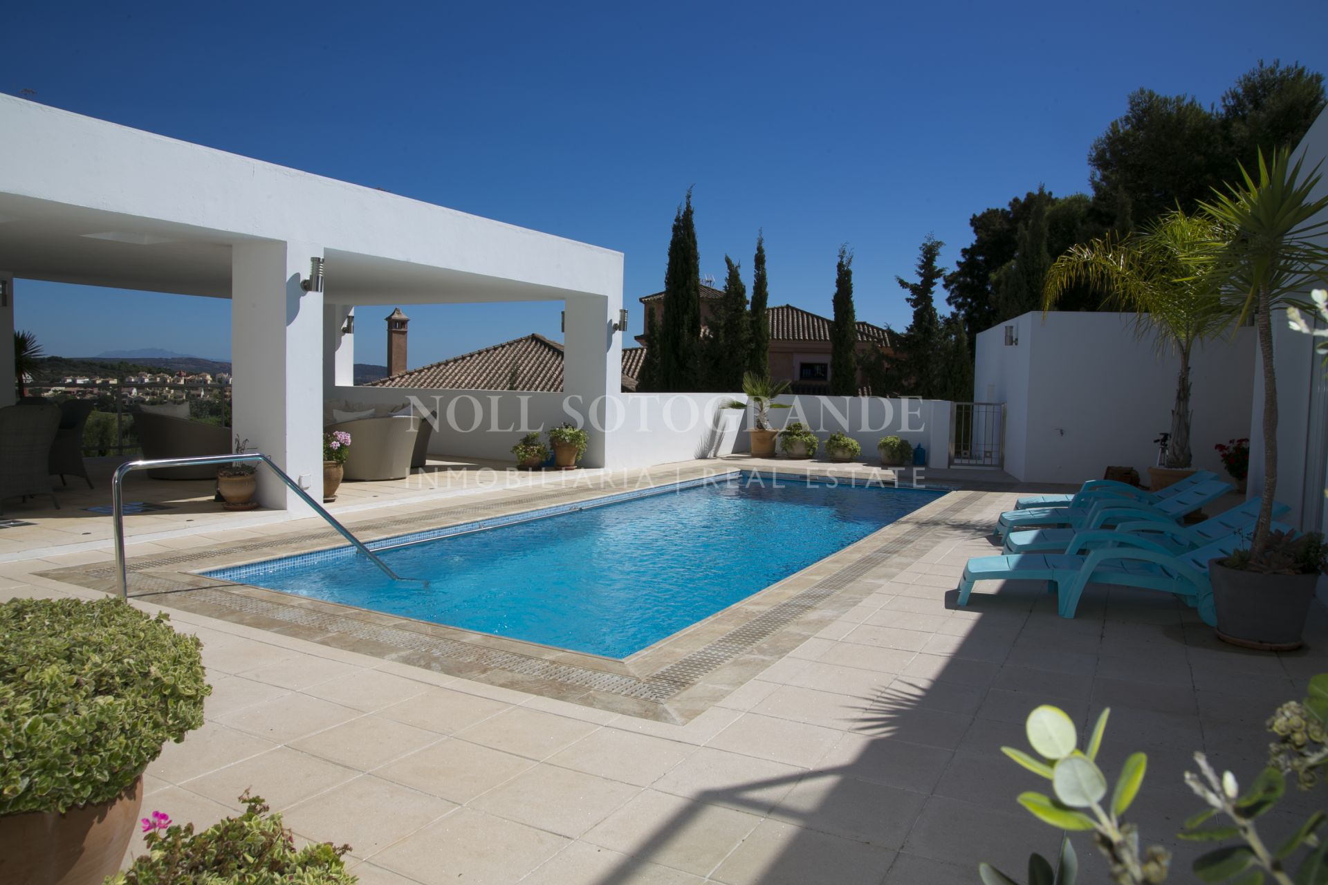 Refurbished modern villa offering spectacular views over La Reserva Golf golf course towards the mountains and the sea.