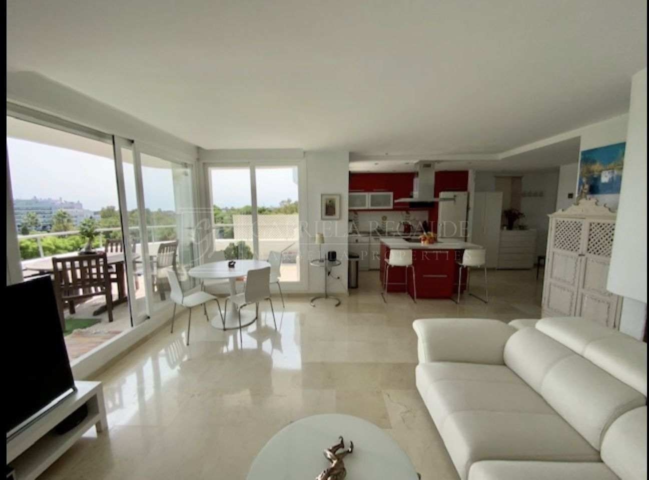 Bright apartment with open golf and sea views.