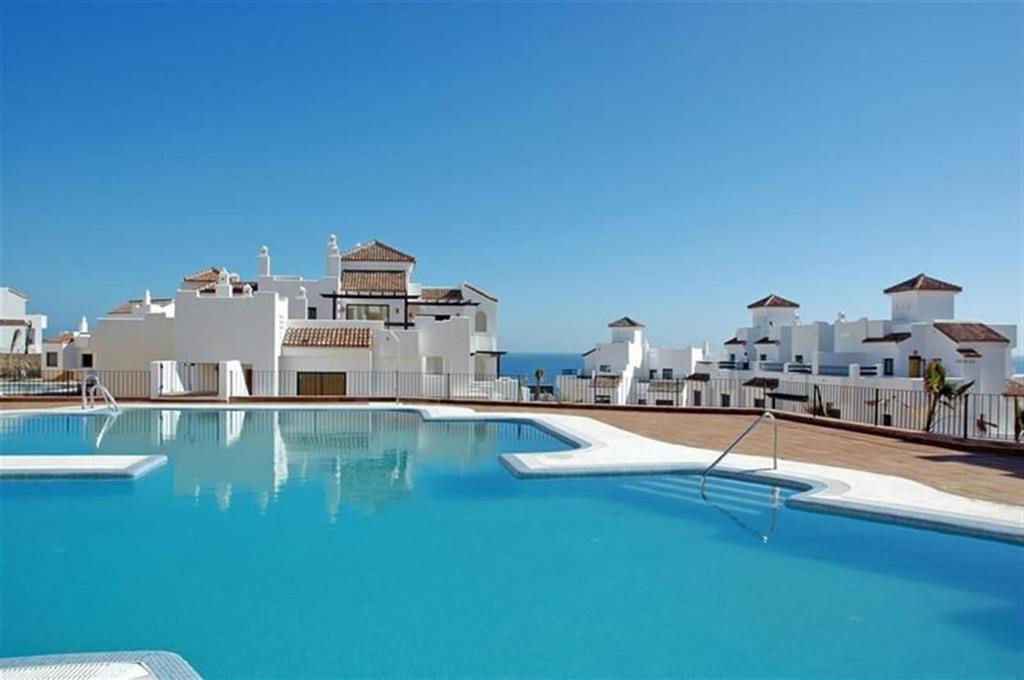 Townhouse for sale on frontline golf with panoramic sea and costal views in Alcaidesa