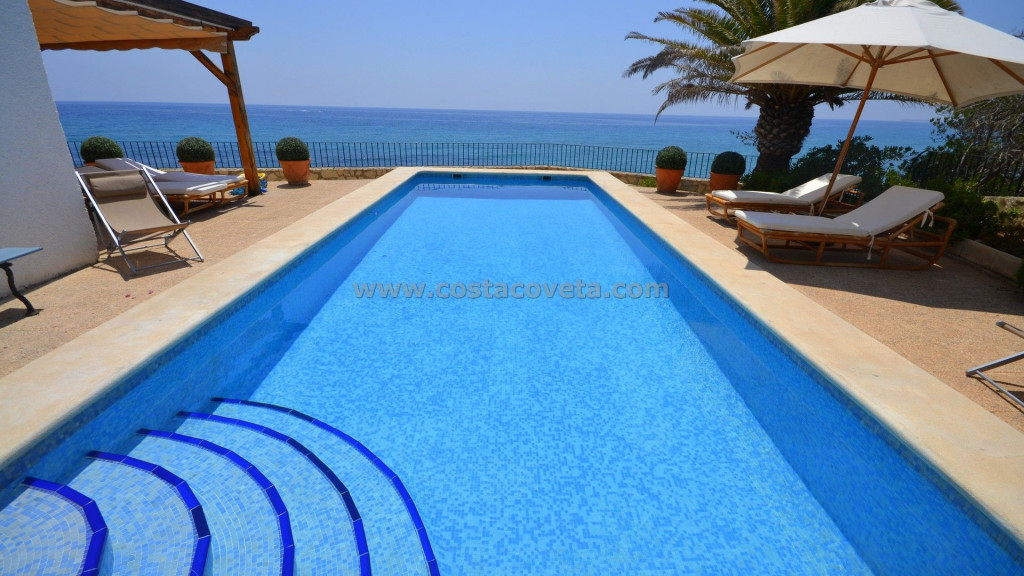 Unique imposing villa with pool on the first-line on the Mediterranean and private sea access.