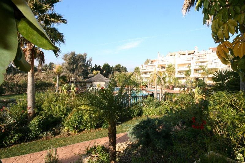 Estepona, Lovely ground floor apartment for sale situated in the front line beach complex of Bahia del Velerin