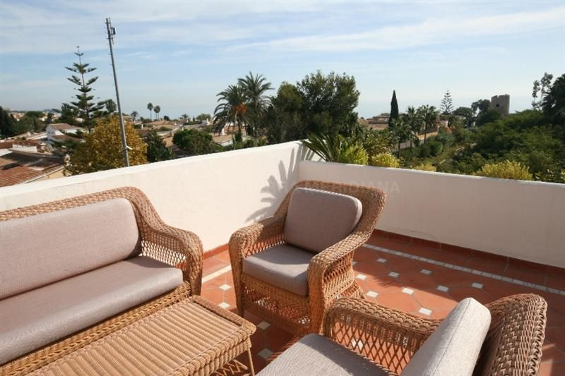 Estepona, Corner townhouse for sale in the front line beach complex Villas de Costalita in Estepona