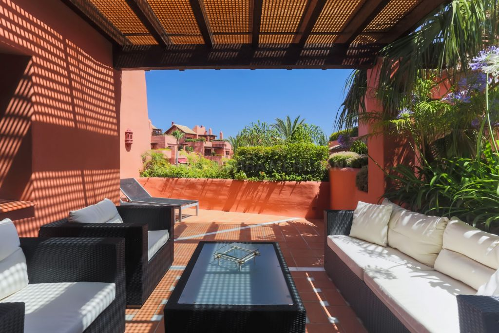 Estepona, Luxury duplex penthouse for sale with two terraces, pools, gardens, direct access to the beach, Torre Bermeja, Estepona