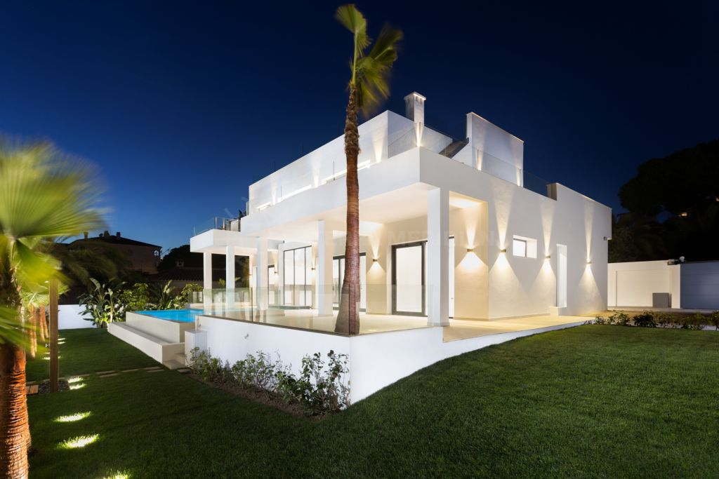 Marbella East, Stunning new 5 bedroom modern villa for sale beach-side in Elviria with glass panel private pool that illuminates the basement
