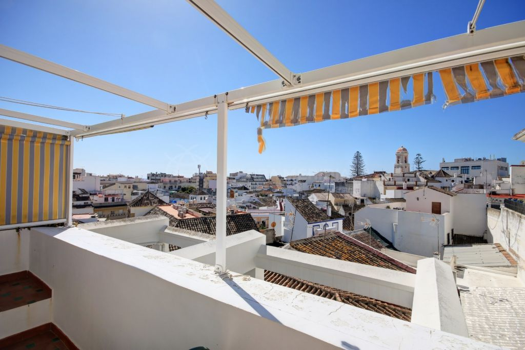 Estepona, Immaculate townhouse for sale in Estepona old town centre of Estepona, near traditional squares and with sea views.