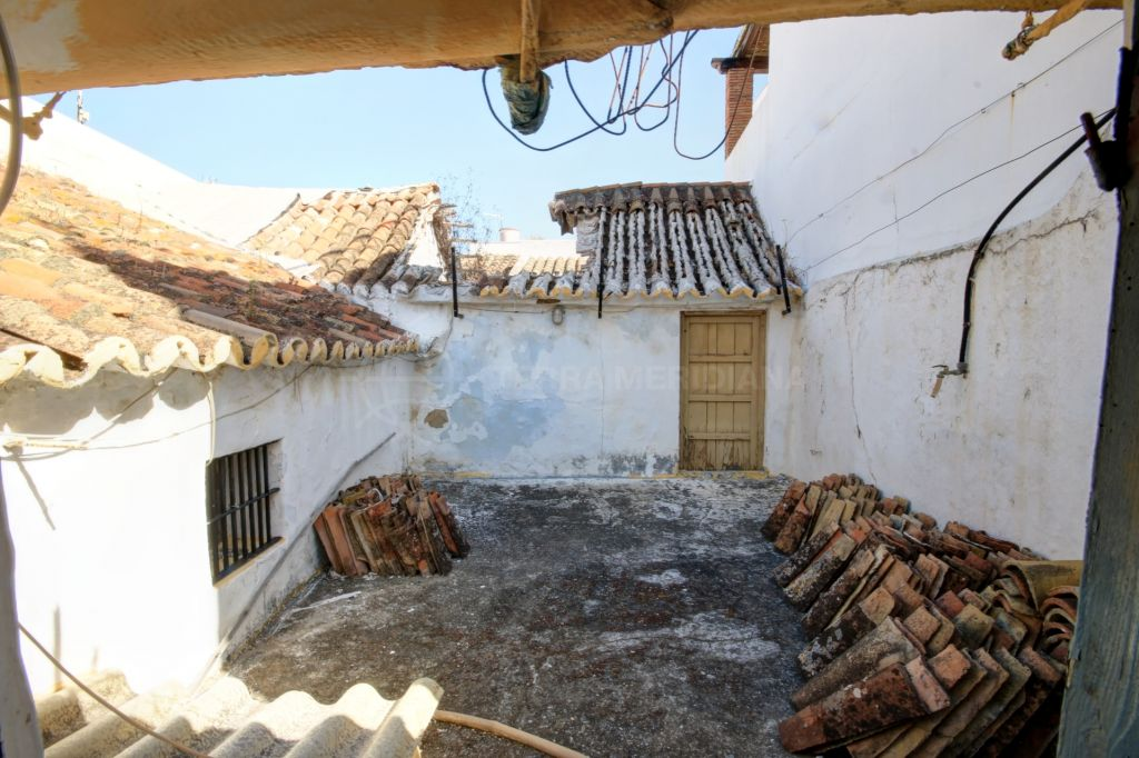 Estepona, Charming townhouse for sale in Estepona old town centre, with large terrace and patio