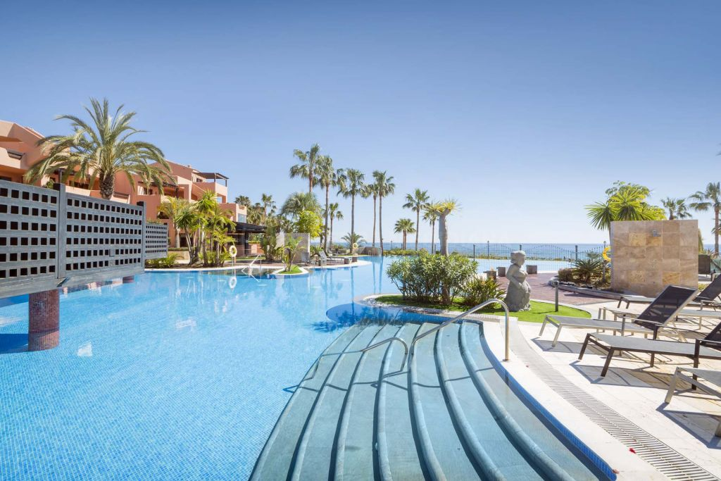 Estepona, Mediterranean style 2 bedroom penthouse apartment for sale, front line beach in Mar Azul, Estepona