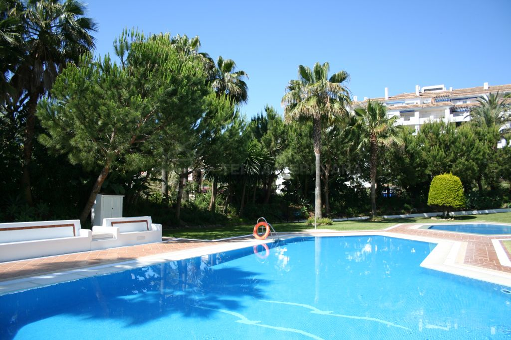Marbella - Puerto Banus, Third floor apartment for sale in Playas del Duque, Puerto Banus with community pools and gardens