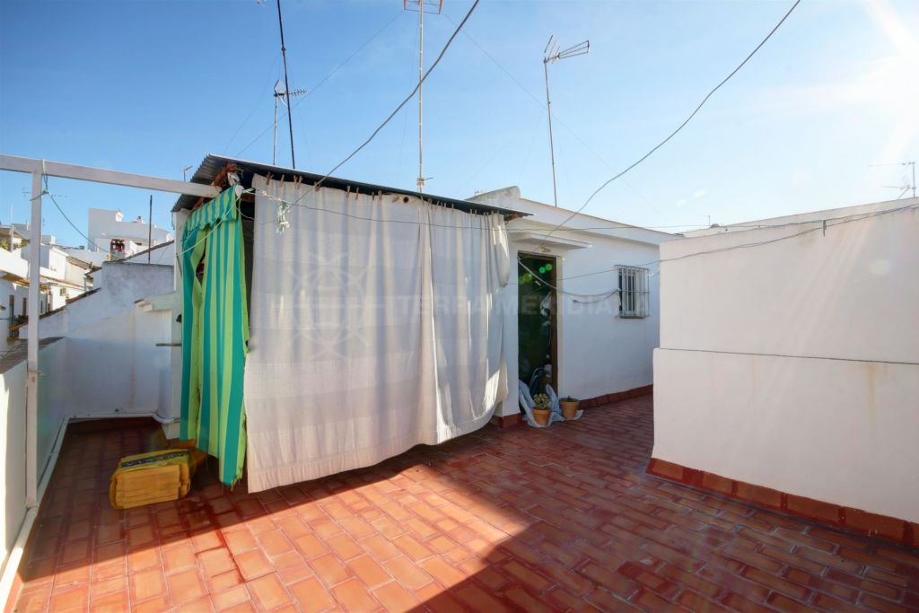 Estepona, Quaint town house for sale in the old town centre of Estepona, with large solarium terrace