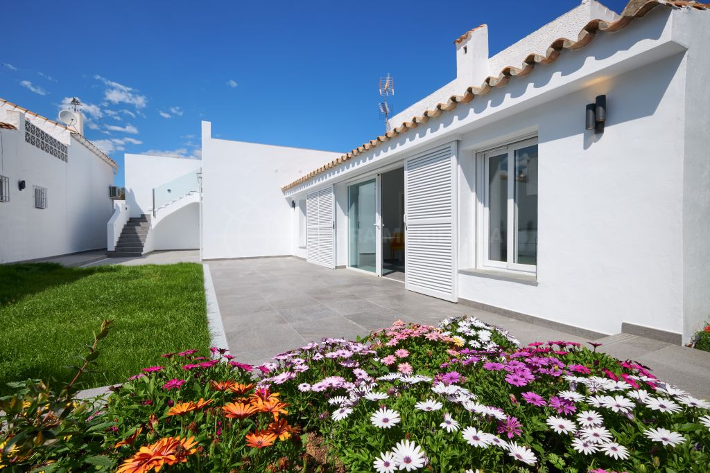 Estepona, Two fully renovated townhouses sold together or separately close to Laguna Village in Puerto Romano, New Golden Mile, Estepona