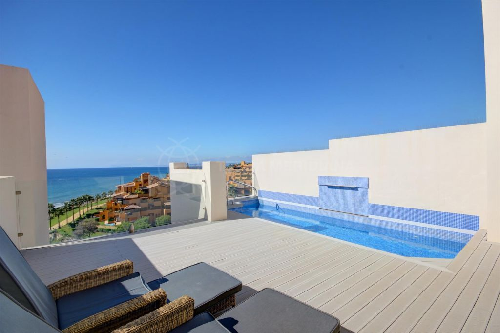 Estepona, Front line beach penthouse for sale in Bahia de la Plata in Estepona, with private pool