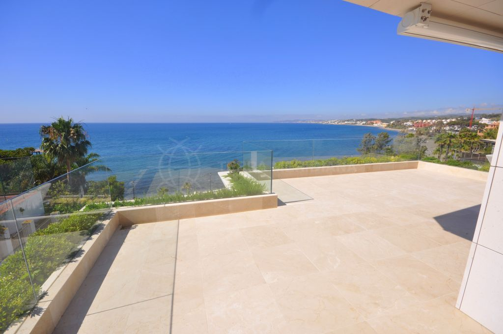 Estepona, Luxury front-line beach apartment with expansive sea views for sale in Les Rivages, Estepona Playa, Estepona
