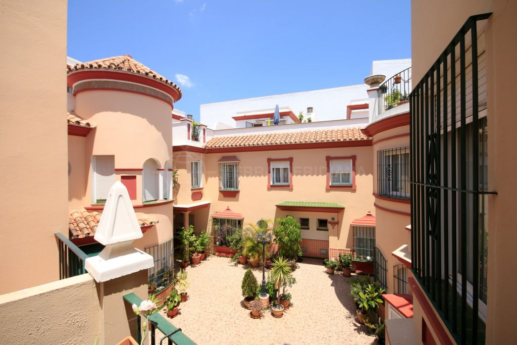 Estepona, two bedroom townhouse in the centre of town with private underground parking space within the gated complex