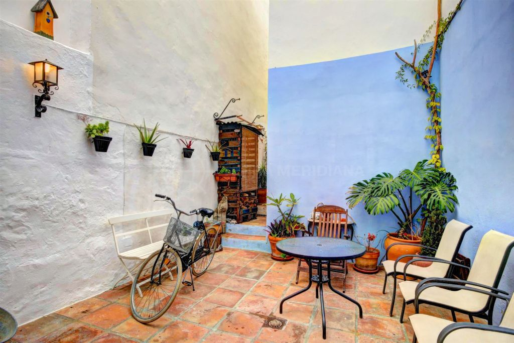 Estepona, REDUCED TO SELL Completely reformed townhouse for sale with large patio in the centre of Estepona town