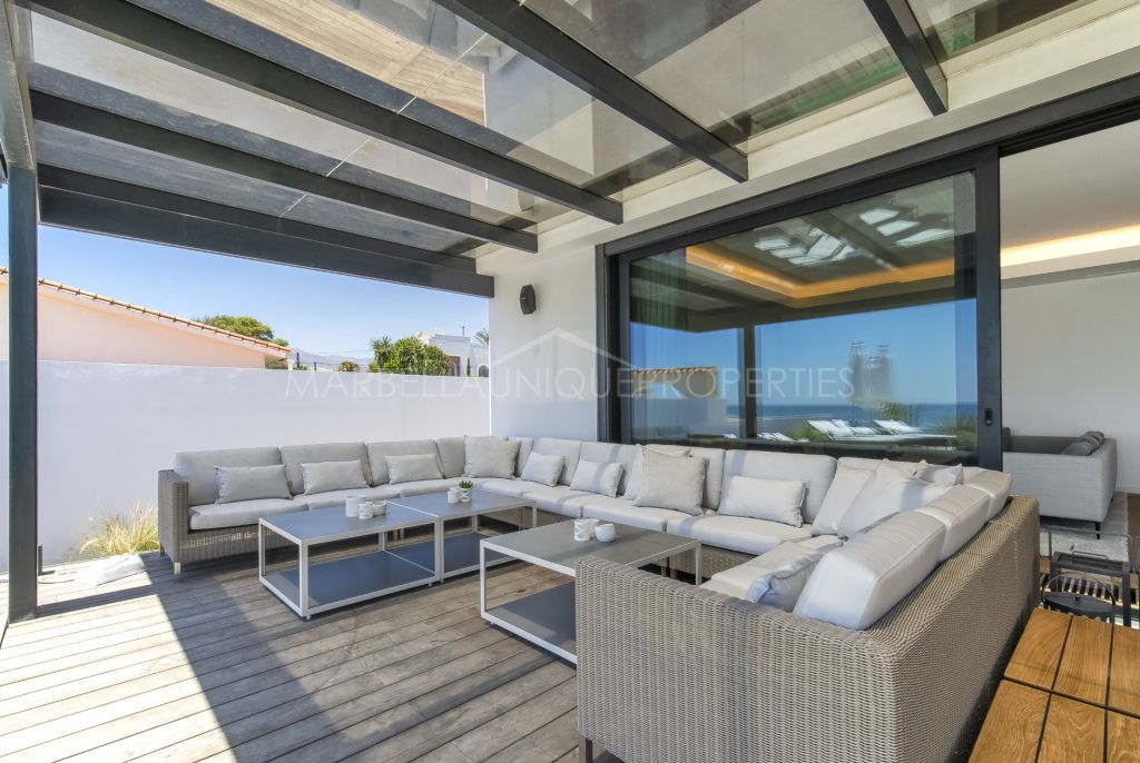 Spectacular frontline property set right on the Costa Bella beach