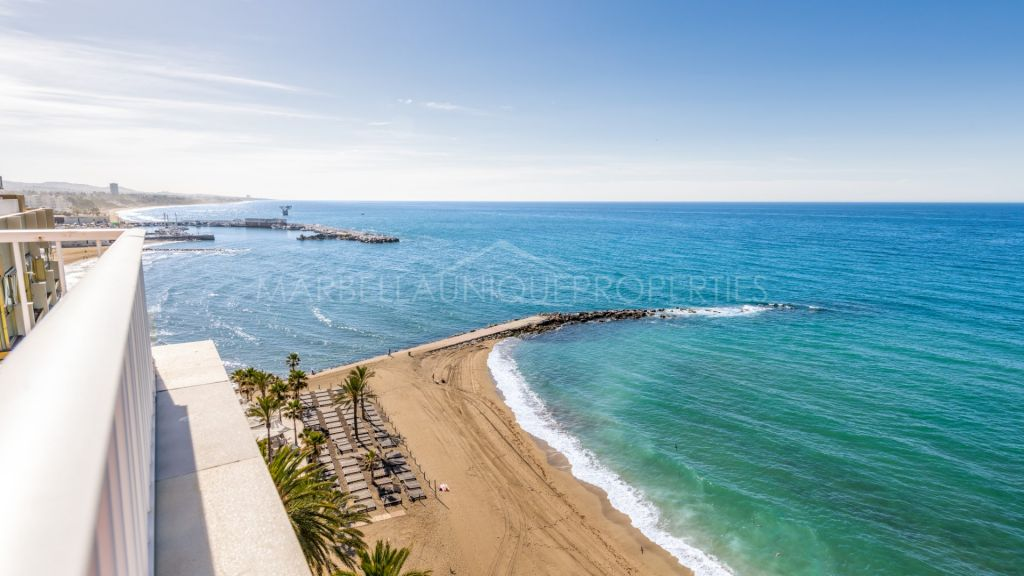 Sea views from this stunning beachfront apartment in Marbella