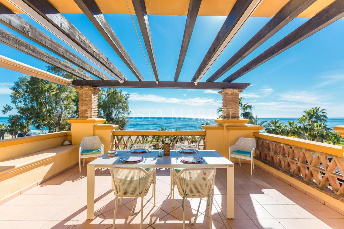 Marbella East, Sunny Marbella frontline beach apartment for sale with amazing sea and beach views