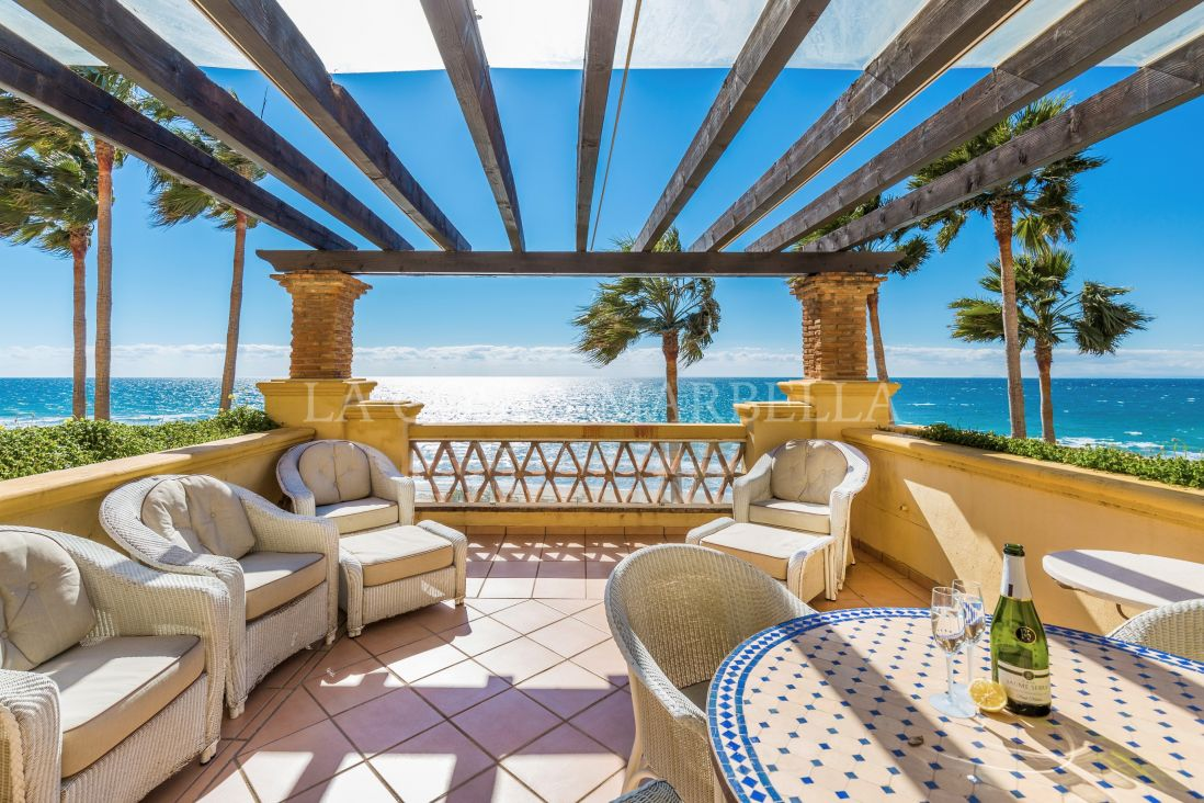 Marbella East, Front line two-bedroom beach apartment with spectacular sea views for sale in Marbella
