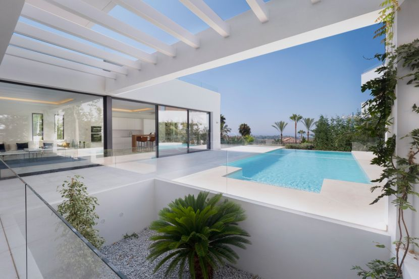 Gated complex of 14 contemporary villas in Benahavis, with golf and sea views