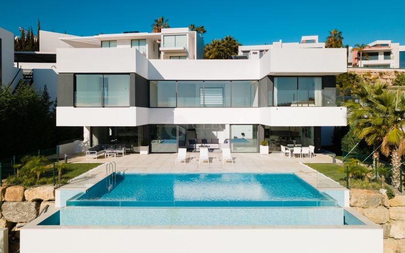 A brand new modern villa for sale, with panoramic sea and golf views