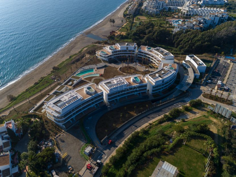 New development of modern apartments, frontline beach for sale in Estepona