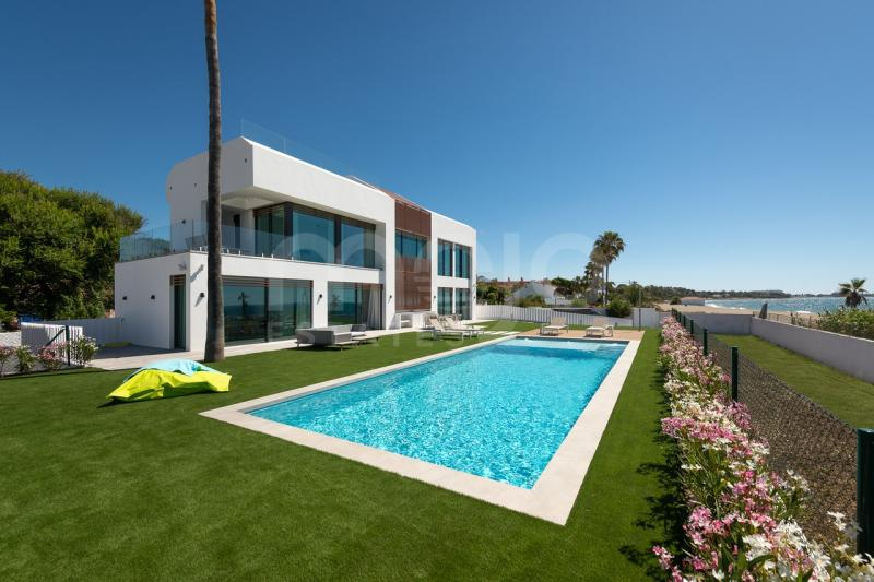 Stunning contemporary villa located front line beach on the New Golden Mile.