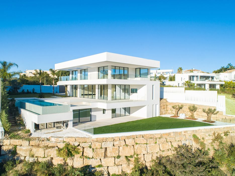 A superb modern villa front line golf with panoramic sea views