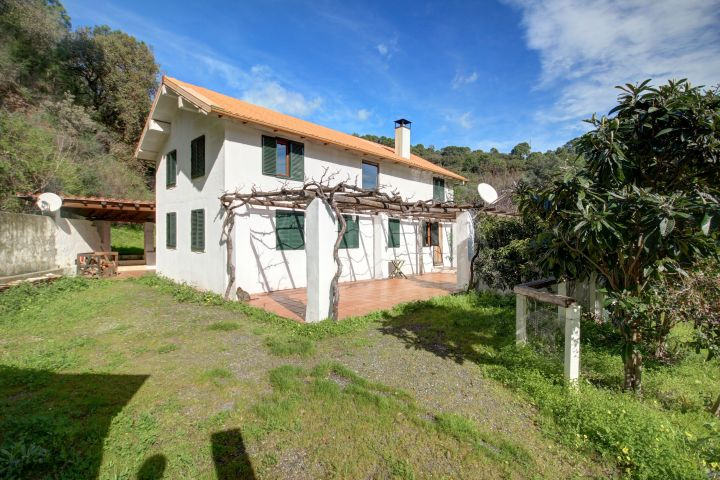 Country estate on the riverside with 2 houses on a sprawling plot for sale in El Padron, Estepona