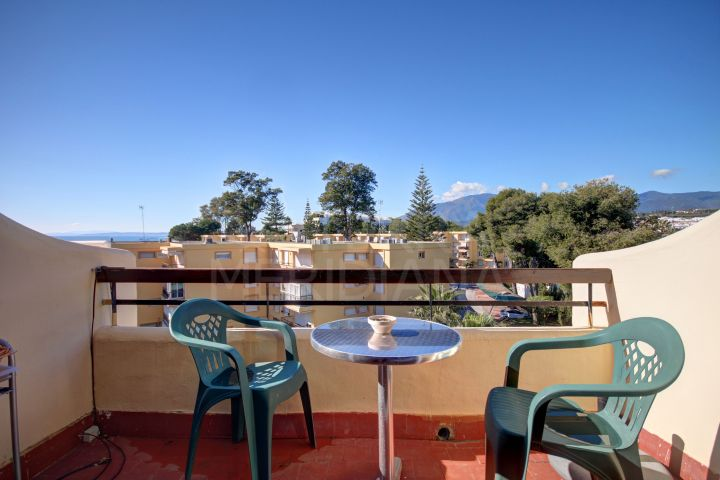Top floor studio apartment in front line beach community for sale on the New Golden Mile, Estepona