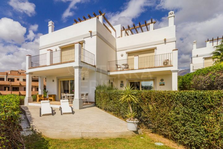 Magnificent front line golf townhouse for sale in Estepona Golf with sea views