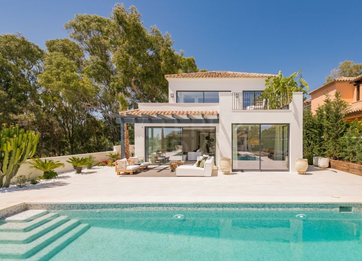 Beautiful 5 bedroom modern Andalucian style villa with sea views for sale in Elviria, Marbella