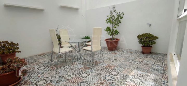 Spacious ground floor apartment for sale with patio in Estepona old town