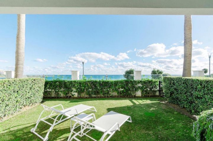 Luxury ground floor 2 bedroom front-line beach apartment for sale in Doncella Beach, Estepona