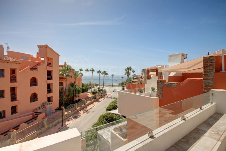 Reformed 4 bedroom townhouse in front-line beach community for sale in Garden Beach, Estepona