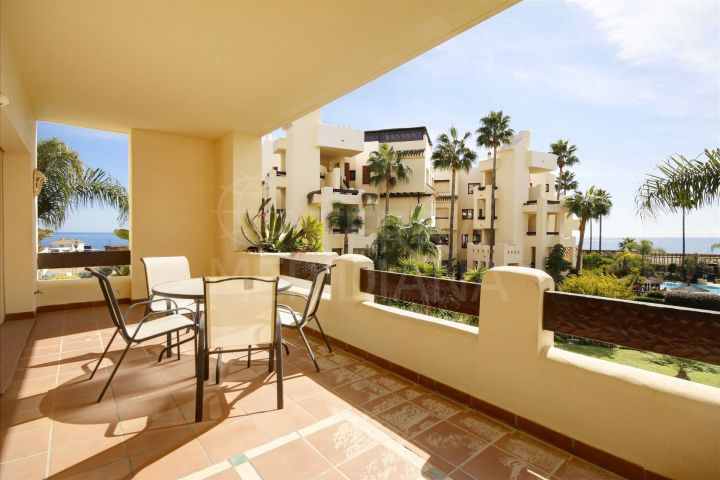 Well presented middle floor apartment for sale in front-line beach complex Bahia del Velerin, Estepona